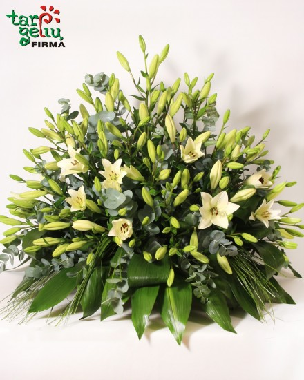 Funeral arrangement with lilies