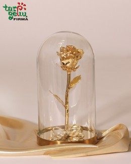Golden rose in a flask